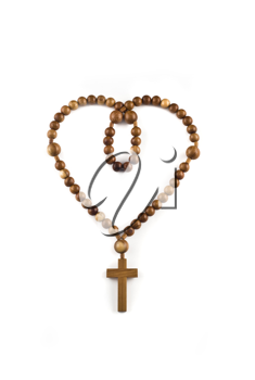 Heart figure made of Wooden beads isolated over white