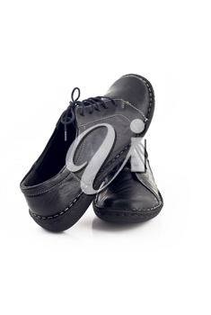Pair of black leather shoes for women over white background