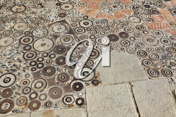 Unusual floor with pattern from pebbles, brick and rusty metal details in the park Montjuic, Barcelona, Catalonia, Spain