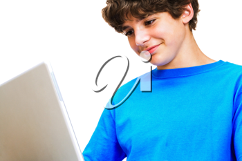 Royalty Free Photo of a Teenage Boy on his Laptop