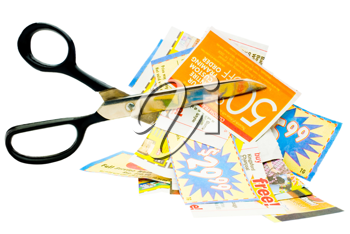 Royalty Free Photo of a Pair of Scissors Cutting Coupons