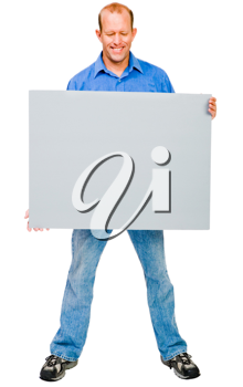 Happy mature man showing a placard isolated over white
