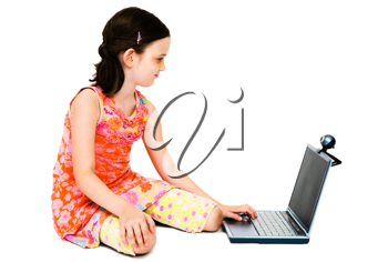 Girl using a laptop and posing isolated over white