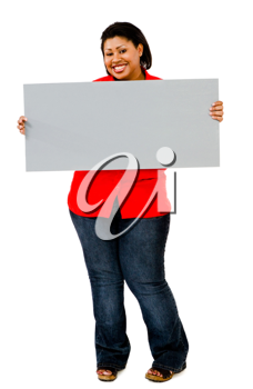 Woman showing an empty placard and smiling isolated over white