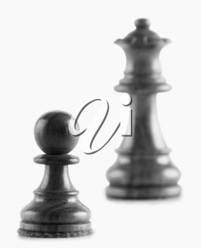 Close-up of a pawn with a queen