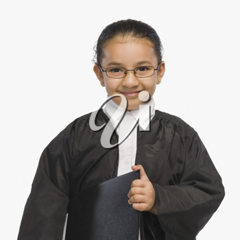 Girl dressed as a lawyer and smiling