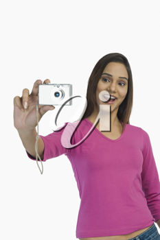 Woman taking a picture with a digital camera