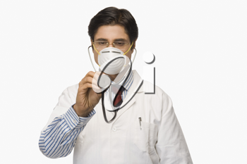 Doctor wearing a flu mask and pretending to listen heartbeat with a stethoscope