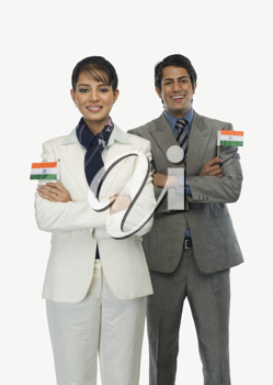 Business executives holding Indian flags