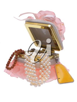 Open box with beads and pearls on a white background.