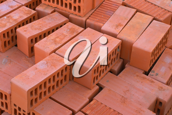 Red bricks silicate with apertures on building.