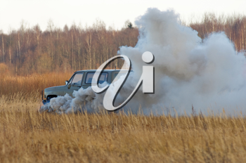 Royalty Free Photo of a Military Transport Explosion in a Field