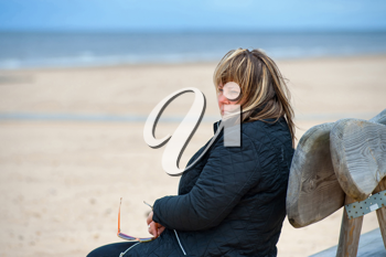 Royalty Free Photo of a Woman Relaxing at the Beach