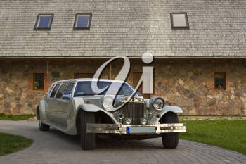 Royalty Free Photo of a Limousine Outside a Building