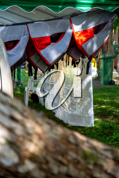Life jackets drying in the summer shed neat the river in Latvia. Life jackets on the Gauja shore.