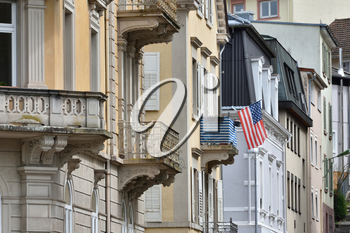 American flag mounted on the balcony of a residential building in Europe, Germany.