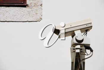 Royalty Free Photo of a Video Surveillance Camera on a Wall