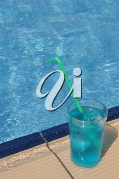 Royalty Free Photo of a Cocktail Beside a Pool