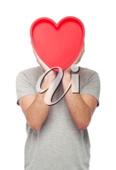 Royalty Free Photo of a Man Holding a Heart