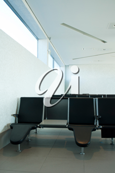 Royalty Free Photo of Empty Seats at Departures Terminal at an International Airport