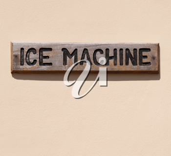 Royalty Free Photo of a Wooden Ice Machine Sign
