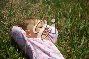 Royalty Free Photo of a Child Lying on Grass