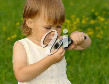 Royalty Free Photo of a Little Girl Looking at a Snail With a Magnifying Glass