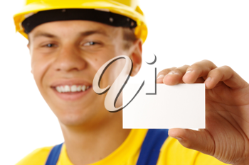 Royalty Free Photo of a Man in a Hardhat Showing a Blank Business Card