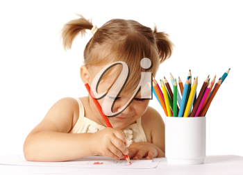 Royalty Free Photo of a Little Girl Writing With a Pencil Crayon