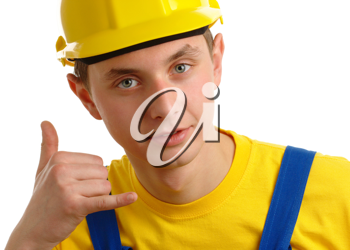 Royalty Free Photo of a Man in a Hardhat Gesturing Call Me