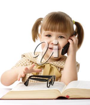Royalty Free Photo of a Girl With Glasses on a Book Talking on a Cellphone