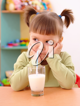 Royalty Free Photo of a Little Girl With a Glass of Milk