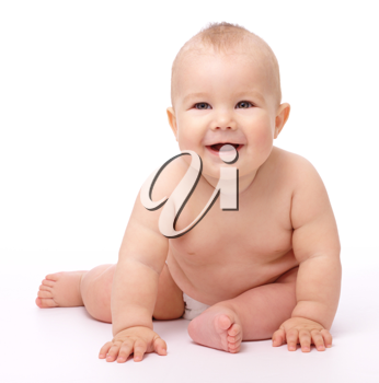 Royalty Free Photo of a Baby Sitting on the Floor