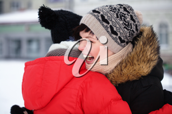 Royalty Free Photo of Two Women Hugging Outside