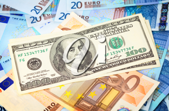 Royalty Free Photo of American Dollars on Top of Euros