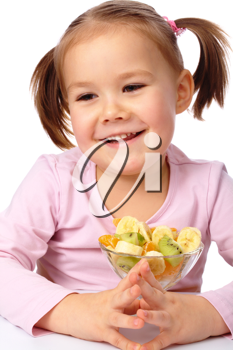 Royalty Free Photo of a Little Girl With a Bowl of Fruit