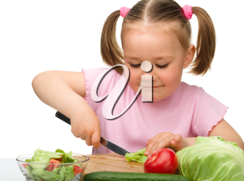 Royalty Free Photo of a Little Girl With Vegetables