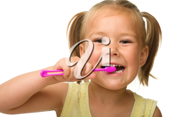 Royalty Free Photo of a Little Girl Brushing Her Teeth