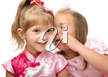 Royalty Free Photo of Two Little Girls Whispering