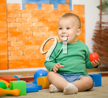 Royalty Free Photo of a Little Boy Playing With Toys