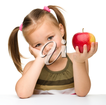 Royalty Free Photo of a Girl With an Apple