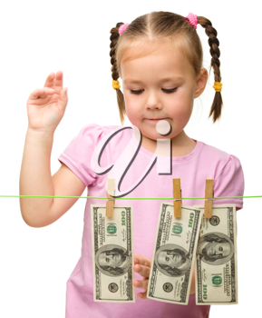 Royalty Free Photo of a Little Girl With Money on the Line