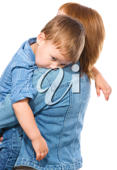 Portrait of a tired little boy embracing his mother, isolated over white