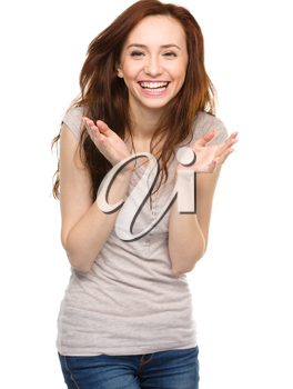 Portrait of a happy young woman, isolated over white