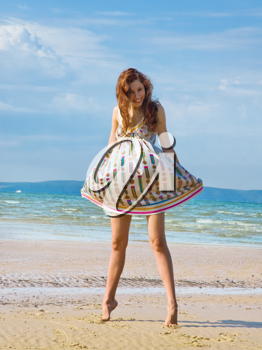 Royalty Free Photo of a Woman in a Short Dress at the Beach