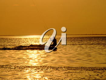 Royalty Free Photo of a Kite Surfer on the Water at Sunset