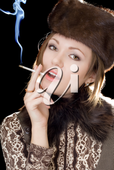 Royalty Free Photo of a Woman Smoking
