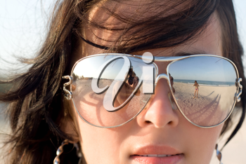 Royalty Free Photo of a Woman With the Photographer Reflected in Her Glasses