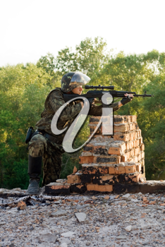 Royalty Free Photo of a Sniper With a Machine Gun