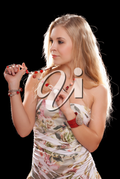 Royalty Free Photo of a Young Woman Playing With Her Necklace